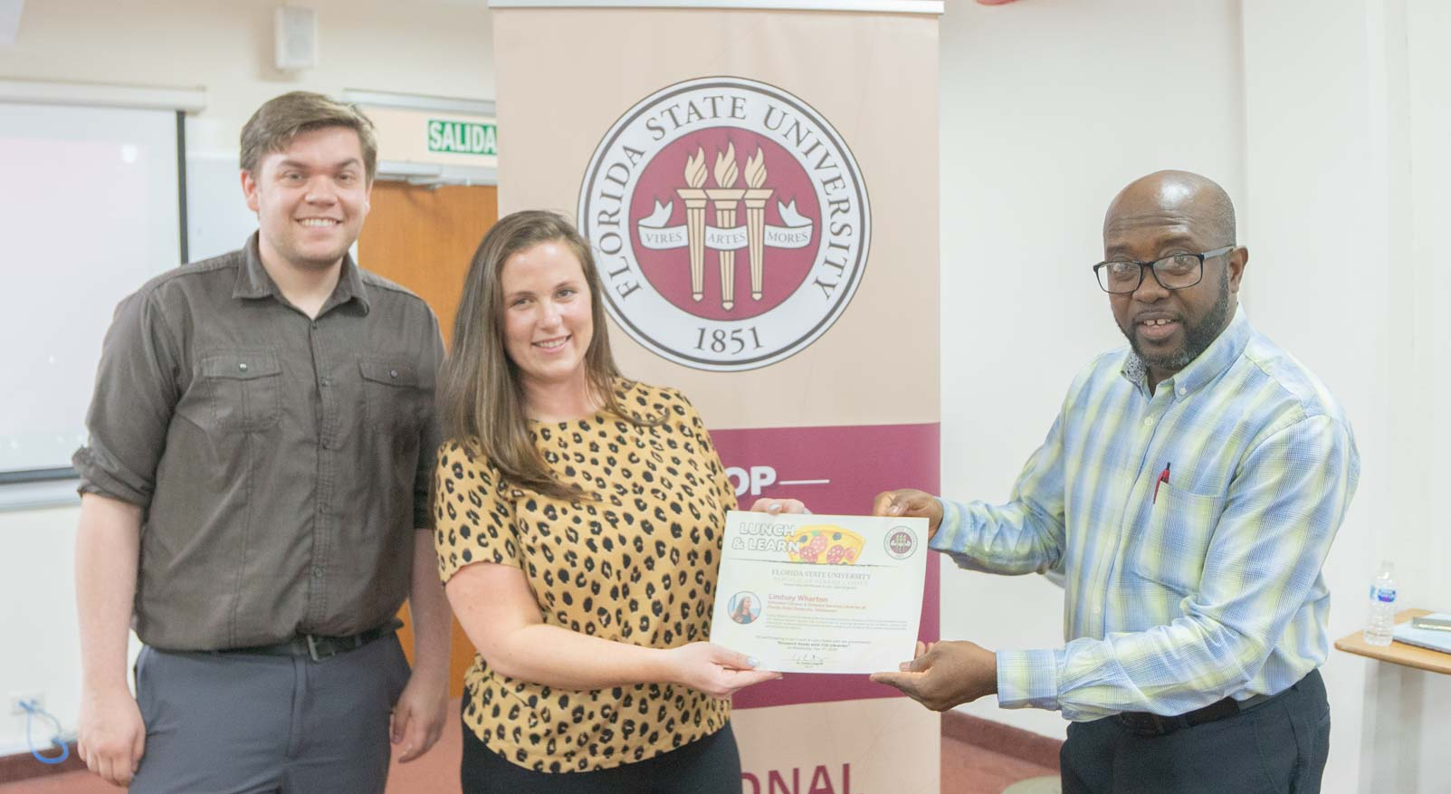Lindsey and Michael receive a certificate at FSU Panama